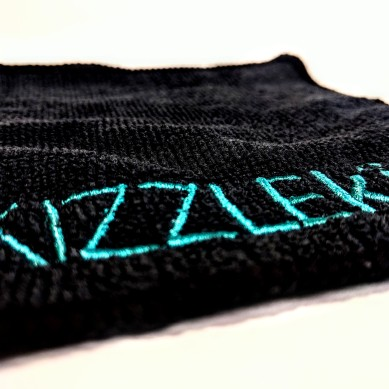 Kizzle Kit's logo in teal on a black microfibre.